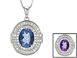 NGH301<br>2.38ct Oval Color Change Blue Fluorite With .44ctw Round White Zircon Silver Pendant With